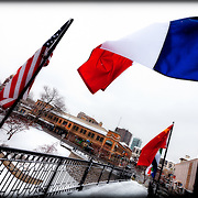 The pedestrian bridge on the Plaza over Brush Creek bears the flags of Kansas City's sister city nations. This photo was from the afternoon during a January 2011 snowfall.