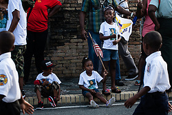 (L-R) Shaydon Moolenaar, A'Ja Frett, and A'Deja Frett.  Veteran's Day Parade and Program at the Frankliin Delano Roosevelt Memorial Park in Charlotte Amalie.  St. Thomas.  11 November 2013.  © Aisha-Zakiya Boyd