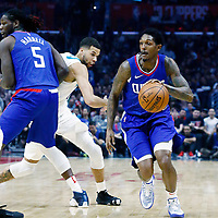31 December 2017: LA Clippers guard Lou Williams (23) drives past Charlotte Hornets guard Michael Carter-Williams (10) on a screen set by LA Clippers forward Montrezl Harrell (5) during the LA Clippers 106-98 victory over the Charlotte Hornets, at the Staples Center, Los Angeles, California, USA.
