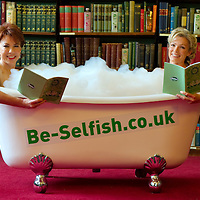 """London September 7th Author Kathy Latte and celeb mum Neil McAndrew are pictured  at the London Library having a """"bath in"""" to encourage busy mums across the UK to take more selfish moments. It marks the launch of Kathy Latte's waterproof book """"All steamed up"""" ,...Standard Licence feee's apply  to all image usage.Marco Secchi - Xianpix tel +44 (0) 7717 298571.http://www.marcosecchi.com"""