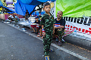 23 MAY 2014 - BANGKOK, THAILAND: A boy in a toy military uniform in the anti-government protest area in Bangkok after a military coup ended the protests. The Thai military seized power in a coup Thursday evening. They suspended the constitution and ended civilian rule. This is the 2nd coup in Thailand since 2006 and at least the 12th since 1932.    PHOTO BY JACK KURTZ