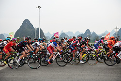 Peloton roll past karst mountains at GREE Tour of Guangxi Women's WorldTour 2019 a 145.8 km road race in Guilin, China on October 22, 2019. Photo by Sean Robinson/velofocus.com