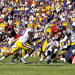 November 6, 2010; Baton Rouge, LA, USA; Alabama Crimson Tide running back Trent Richardson (3) runs against the LSU Tigers during the first half at Tiger Stadium.  Mandatory Credit: Derick E. Hingle