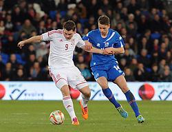 Sam Vokes of Wales (Burnley) holds the ball up from Kari Arnson (Rotherham United) of Iceland - Photo mandatory by-line: Dougie Allward/JMP - Tel: Mobile: 07966 386802 03/03/2014 -