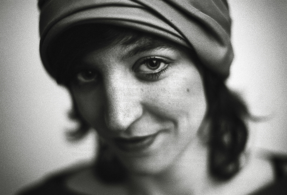 Close up of a woman wearing a hat