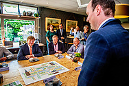 ESBEEK - King Willem-Alexander during a working visit to citizens' initiatives in the Brabant town. ANP ROYAL IMAGES ROBIN UTRECHT