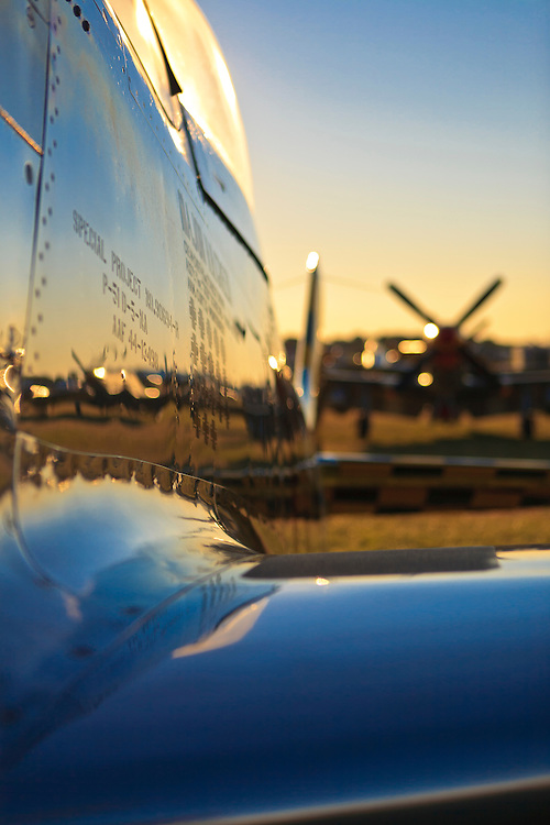 Sunrise reflected in the highly polished wing and fuselage of a P-51D Mustang, during AirVenture 2008, Oshkosh, Wisconsin.