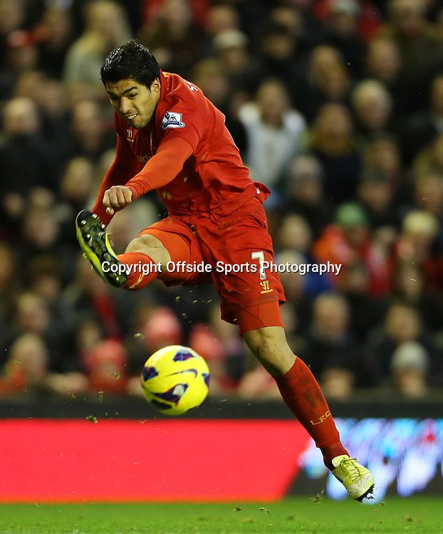 17th November 2012 - Barclays Premier League - Liverpool vs. Wigan Athletic - Luis Suarez of Liverpool shoots - Photo: Simon Stacpoole / Offside.