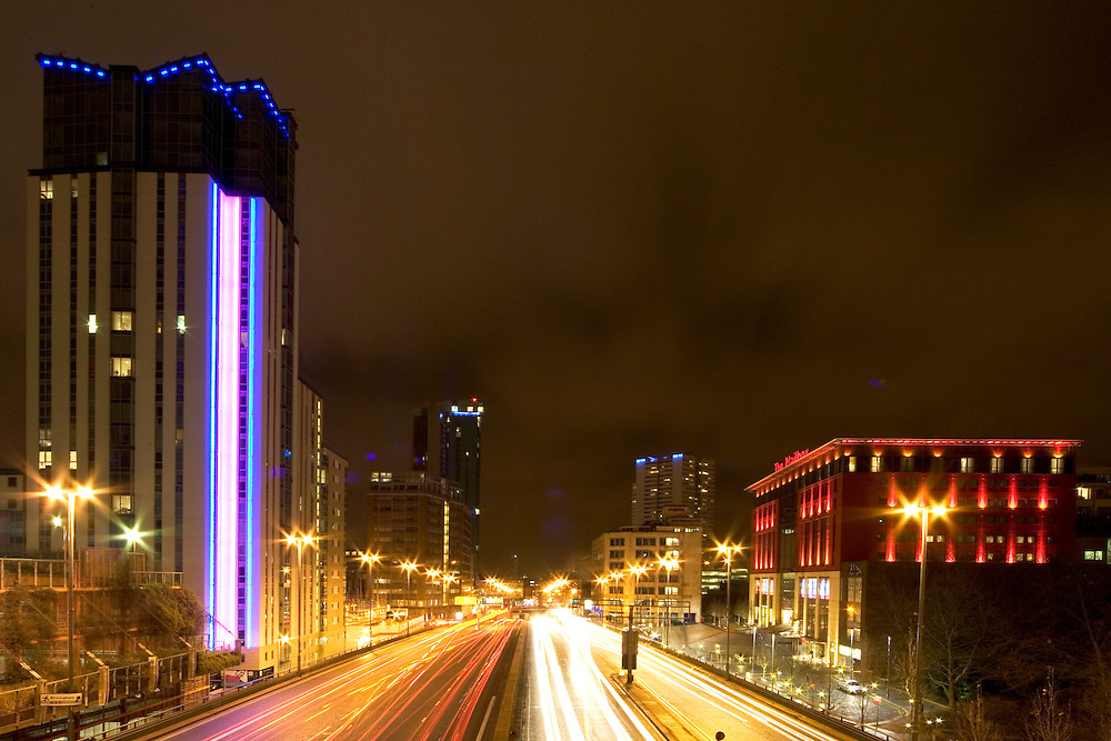 The Mailbox and Orion buildings at night with traffic trails.