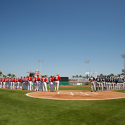 February 27, 2011; Clearwater, FL, USA; Players for the Philadelphia Phillies and New York Yankees lineup for the national anthem prior to the start of a spring training exhibition game at  Bright House Networks Field. Mandatory Credit: Derick E. Hingle
