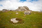 People scrambling on the granite tor of Haytor, Dartmoor national park, Devon, England