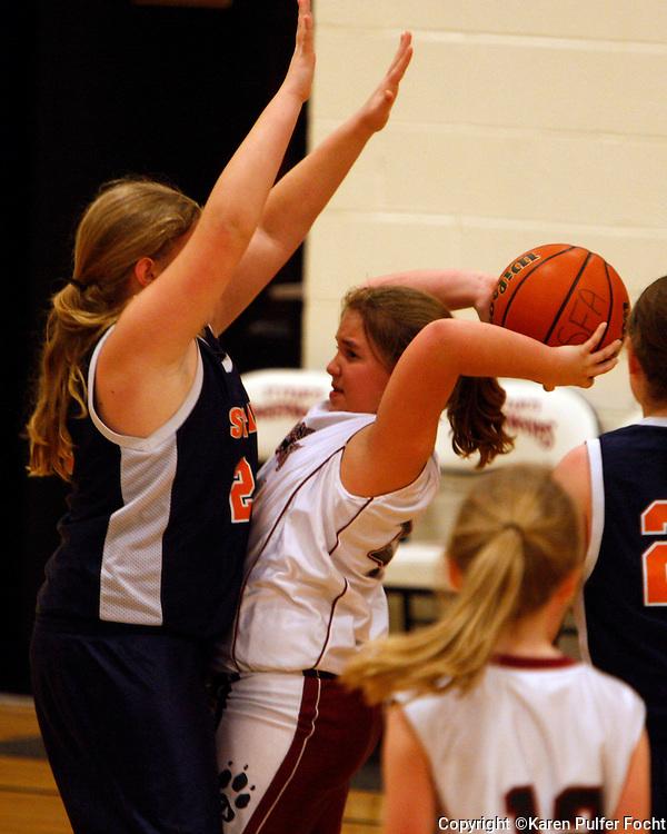 Elli Rose Focht plays middle school basketball.