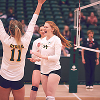3rd year middle blocker, Rebecca Wood (14) of the Regina Cougars celebrates during the Women's Volleyball pre-season game on Sat Sep 22 at Centre for Kinesiology, Health & Sport. Credit: Arthur Ward/Arthur Images