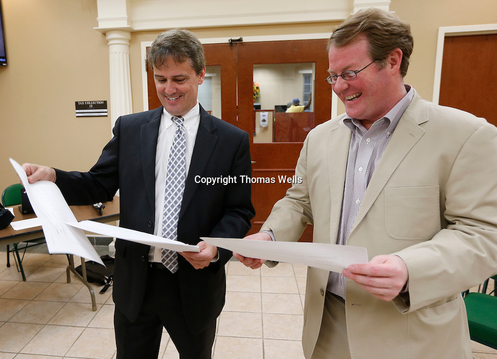 Thomas Wells | BUY at PHOTOS.DJOURNAL.COM<br /> Greg Pirkle, left, and Tupelo Mayor Jason Shelton look over the returns of Tuesday's vote for Phase 6 of the Major Throughfare project at City Hall.