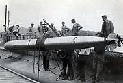 Shipping a torpedo on board the French submarine 'Xiphia'.