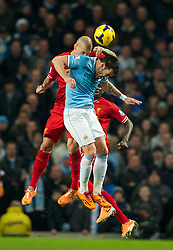 MANCHESTER, ENGLAND - Boxing Day Thursday, December 26, 2013: Liverpool's Martin Skrtel in action against Manchester City's Alvaro Negredo during the Premiership match at the City of Manchester Stadium. (Pic by David Rawcliffe/Propaganda)