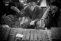 Man sells incense stick on Xa Phin market, Ha Giang Province, Vietnam, Southeast Asia