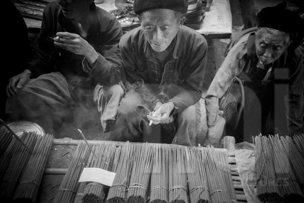 Man sells incense stick on Xa Phin market, Ha Giang Province, Vietnam, Southeast Asia