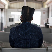 """A woman, 21, who dates a 45-year-old man who helps her financially comes to the Vulindlela clinic for contraception and to talk with other women. In the rural community, women don't have any place to socialize besides the clinic. Philile has two boyfriends. The idea of having a sugar daddy, or """"blesser"""", has become a widely normalised concept in South Africa.Vulindlela, South Africa. 7 November 2017. © 2017 Miora Rajaonary. All rights reserved."""