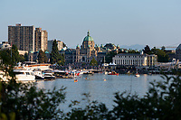 Victoria, BC, hosts the Symphony Splash in the Inner Harbour on the August long weekend. Boaters and music lovers gather in front of the BC Legislative Buildings to enjoy the Victoria Symphony perform.