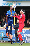 Tom Elliott forward for AFC Wimbledon (9) and Mathieu Baudry defender for Leyton Orient (6) tussle during the Sky Bet League 2 match between AFC Wimbledon and Leyton Orient at the Cherry Red Records Stadium, Kingston, England on 23 April 2016. Photo by Stuart Butcher.
