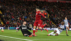 Liverpool's Roberto Firmino misses a chance during the Premier League match at Anfield, Liverpool.