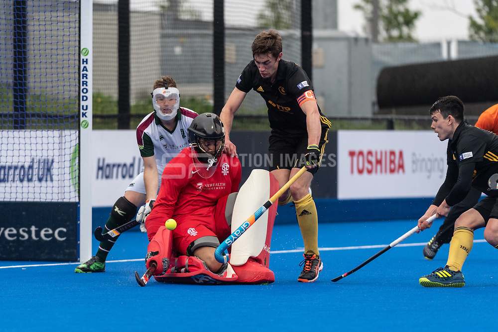 Surbiton's Harry Gibson saves a Beeston penalty corner. Surbiton v Beeston - Men's Hockey League Finals, Lee Valley Hockey & Tennis Centre, London, UK on 28 April 2018. Photo: Simon Parker