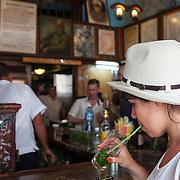 Tourist finishes a mojito at the famous bar La Bodeguita del Medio on Obispo Street in La Habana Vieja.<br /> Photography by Jose More
