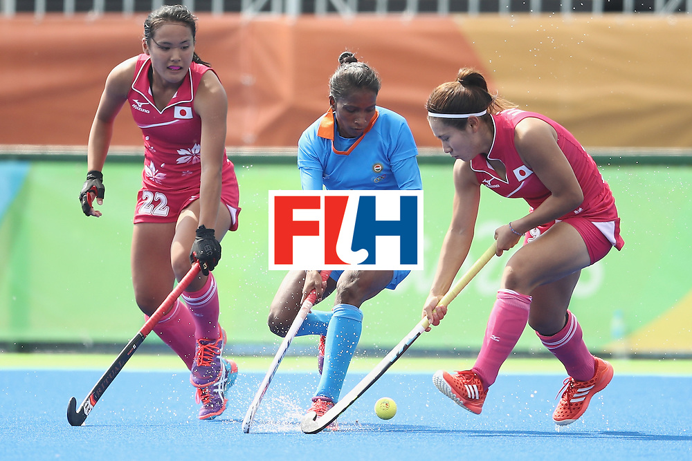 RIO DE JANEIRO, BRAZIL - AUGUST 07: Nikki Pradhan of India competes for ball with Motomi Kawamura and Yuri Nagai of Japan during the women's pool B match between Japan and India on Day 2 of the Rio 2016 Olympic Games at the Olympic Hockey Centre on August 7, 2016 in Rio de Janeiro, Brazil.  (Photo by Mark Kolbe/Getty Images)