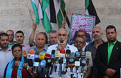August 14, 2017 - Gaza City, Gaza Strip, Palestinian Territory - Palestinian members of the factions attend in a press conference, in front of Red Cross Office, in Gaza city, on August 14, 2017  (Credit Image: © Mohammed Asad/APA Images via ZUMA Wire)
