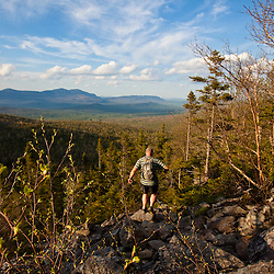 A man hikes the Appalachian Trail on Crocker Mountain in Stratton, Maine.