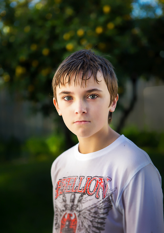 Portrait of a boy with wet hair in front of a lemon tree. melbourne photographers, commercial photographers, industrial photographers, corporate photographer, architectural photographers, This photograph can be used for non commercial uses with attribution. Credit: Craig Sillitoe Photography / http://www.csillitoe.com<br />