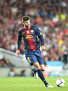 Gerard Pique in action for Barca. Barcelona v Real Madrid, Supercopa first leg, Camp Nou, Barcelona, 23rd August 2012...Credit - Eoin Mundow/Cleva Media.