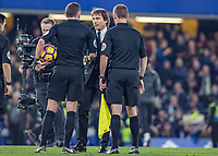 Football - 2016/2017 Premier League - Chelsea V Tottenham Hotspur<br /> <br /> Chelsea Manager Antonio Conte congratulates referee Michael oliver and his team at the final whistle at Stamford Bridge.<br /> <br /> COLORSPORT/DANIEL BEARHAM