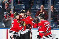 KELOWNA, CANADA - MARCH 2: Seth Jarvis #24, Jaydon Dureau #22 and Jared Freadrich #27 of the Portland Winterhawks celebrate a first period goal against the Kelowna Rockets on March 2, 2019 at Prospera Place in Kelowna, British Columbia, Canada.  (Photo by Marissa Baecker/Shoot the Breeze)