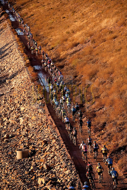 Riders make their way through the mountains and past dams in the early light  during stage 5 of the 2011 Absa Cape Epic Mountain Bike stage race from Worcester Gymnasium to Oak Valley on the 1st April 2011..Photo by Karin Schermbrucker/Cape Epic/SPORTZPICS