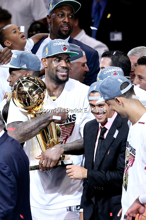 Jun 21, 2012; Miami, FL, USA; Miami Heat small forward LeBron James (6) celebrates with the Larry O'Brien Trophy after winning the NBA championship in game five of the 2012 NBA Finals against the Oklahoma City Thunder at the American Airlines Arena. Miami won 121-106. Mandatory Credit: Derick E. Hingle-US PRESSWIRE