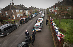 © Licensed to London News Pictures. 11/04/2018. London, UK. Reporters and TV news crews wait in South Park Crescent where floral tributes to burglar Henry Vincent have been placed near the house of Richard Osborn-Brooks (top left). Henry Vincent was killed as he burgled the home of 78 year old Richard Osborn-Brooks. Mr Osborn-Brooks was arrested for murder but later released without charge. Friends and family of Henry Vincent have had floral tributes they placed near the scene repeatedly torn down by locals. Photo credit: Peter Macdiarmid/LNP