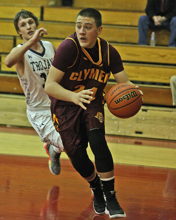Clymer's Dylan Davis drives the baseline during second quaarter action against Southwestern 12-7-15 photo by Mark L. Anderson