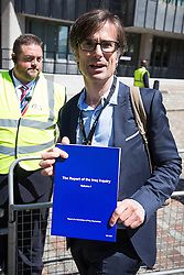 © Licensed to London News Pictures . 06/07/2016 . London , UK . ROBERT PESTON with one of the first copies of the report , leaving the venue . Scene outside the Queen Elizabeth II Conference Centre in Westminster , ahead of the publication of the Chilcot Inquiry's report in to the 2003 invasion of Iraq . Photo credit : Joel Goodman/LNP
