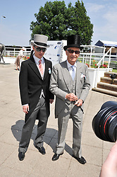 LESTER PIGGOTT and JAMIE PIGGOTT at the Investec Derby at Epsom Racecourse, Epsom Downs, Surrey on 4th June 2011.
