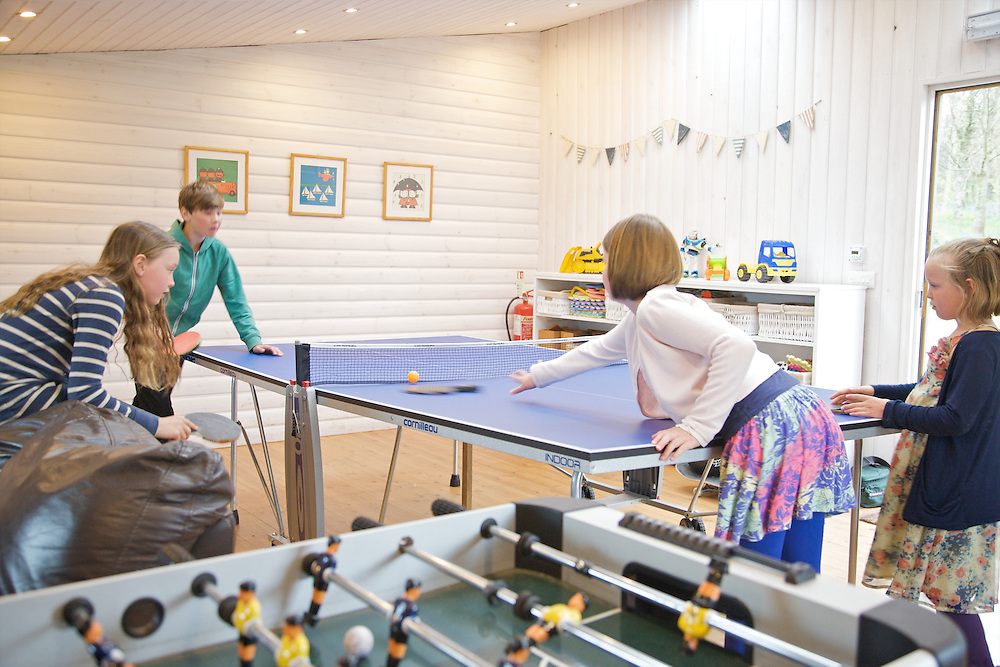 The games room at Pickwell Manor, Georgeham, North Devon, UK. From left to right: Molly Elliott (10), Zac Baker (11), Liza Baker (9),<br /> Milly-grace Elliott (8).<br /> CREDIT: Vanessa Berberian for The Wall Street Journal<br /> HOUSESHARE