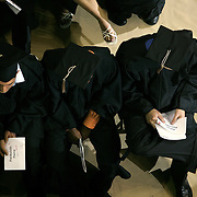 Graduates at Drake University relax before receiving their diplomas...The private University in Des Moines, Ia., has been lauded for it's outstanding programs in the arts in addition to having one of the best law schools and pharmacy departments in the country.