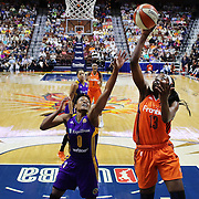 UNCASVILLE, CONNECTICUT- JULY 15:  Chiney Ogwumike #13 of the Connecticut Sun drives to the basket  defended by Alana Beard #0 of the Los Angeles Sparks during the Los Angeles Sparks Vs Connecticut Sun, WNBA regular season game at Mohegan Sun Arena on July 15, 2016 in Uncasville, Connecticut. (Photo by Tim Clayton/Corbis via Getty Images)