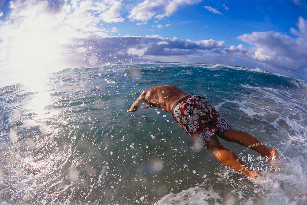 Kauai, Hawaii, USA --- Swimmer Diving into Ocean