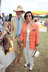 VISCOUNT COWDRAY and BIANCA JAGGER at the Veuve Clicquot Gold Cup polo final held at Cowdray Park, Midhurst, West Sussex on 18th July 2010.