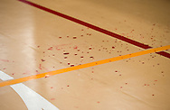 """""""Blood"""" dots the floor outside the ring after a dramatic pre-bout encounter at Championship Wrestling Entertainment's Live Pro Wrestling event at the Port St. Lucie Civic Center on Friday, May 15, 2015. (XAVIER MASCAREÑAS/TREASURE COAST NEWSPAPERS)"""