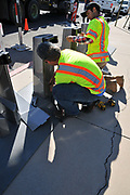 Workers at Tugo Bike Share's Rio Nuevo Station installation.