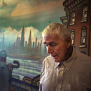 MANASSAS, VA - NOV21:  George Moseley stands by a hallway mural he painted at Birmingham Green, an elder care residence in Manassas, VA, November 21, 2014. With the U.S. population aging and Alzheimer's more widespread, science is looking for ways to slow or delay the onset of dementia in aging Americans. Among the approaches is trying to determine whether art, music and dance or movement can also alleviate the problems attendant with dementia. The federal government is funding a study at Birmingham Green with George Mason University to see whether there is a scientific basis to believe that art is actually medically beneficial. (Photo by Evelyn Hockstein/For The Washington Post)