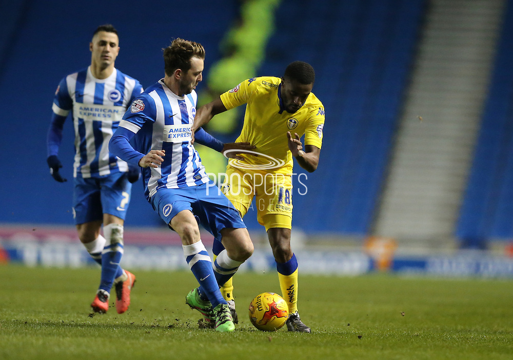 Leeds United midfielder, Mustapha Carayol (18) and Brighton central midfielder, Dale Stephens (6) during the Sky Bet Championship match between Brighton and Hove Albion and Leeds United at the American Express Community Stadium, Brighton and Hove, England on 29 February 2016.